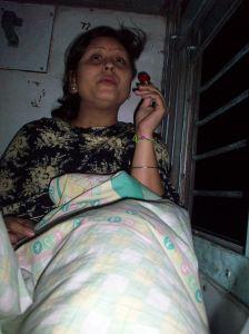 Pooja eating a tootsie pop